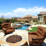 Four rust/brown colored chairs surround custom fire pit